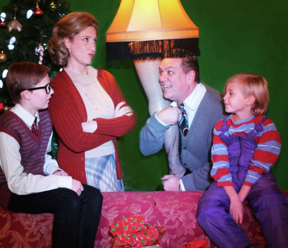 "Actors, from left, Clayton Anderson, Rebecca Trinidad, Marc Daratt and Jack Dullnig play the family in ""A Christmas Story"" at the Woodlawn Theatre. Photo: Courtesy Photo"