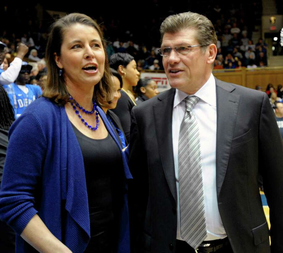 Duke head coach Joanne P. McCallie talks with Connecticut head coach Geno Auriemma before the start of their NCAA women's college basketball game, Monday, Jan. 30, 2012, in Durham, N.C.  Connecticut won 61-45. (AP Photo/Sara D. Davis) Photo: SARA D. DAVIS, Associated Press / AP