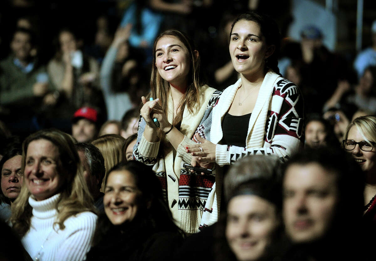 Fans get on their feet at the John Mayer/ Phillip Phillips concert at the Webster Bank Arena in Bridgeport, Conn. on Monday, December 16, 2013.