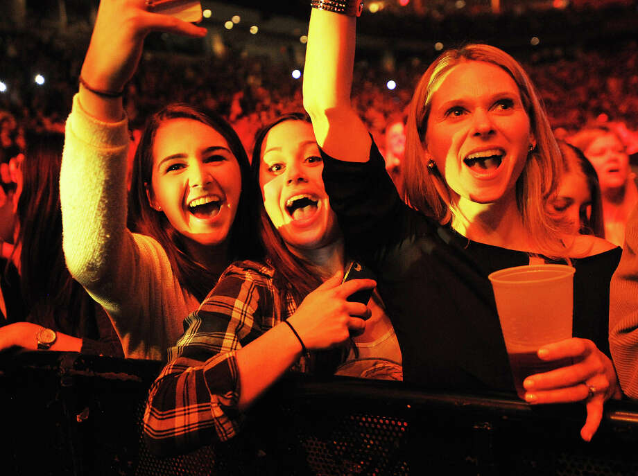 Front row fans at the John Mayer concert at the Webster Bank Arena in Bridgeport, Conn. on Monday, December 16, 2013. Photo: Brian A. Pounds / Connecticut Post