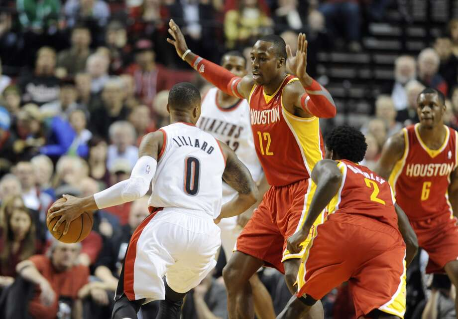 Rockets center Dwight Howard expects smoother performances - and fewer breakdowns forcing him to pick up guards - after more time to mesh. Photo: GREG WAHL-STEPHENS, FRE / FR29287 AP