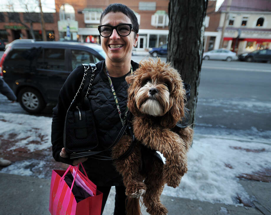 Chiara Rudzin of Westport and Rudy Rags, her Cavapoochon, do some holiday shopping on the Post road in Downtown Fairfield, Conn. on Monday, December 16, 2013. Photo: Brian A. Pounds / Connecticut Post