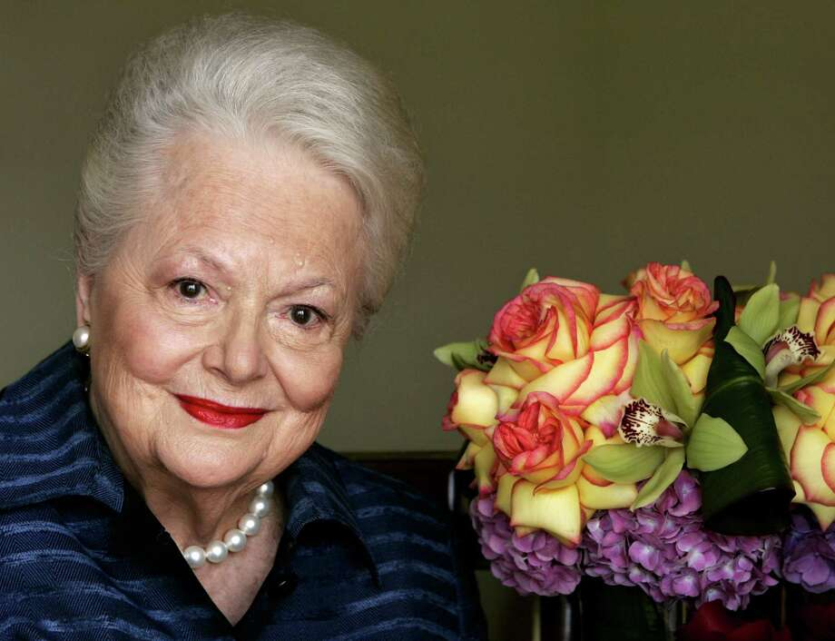 "FILE - In this Wednesday, Sept. 15, 2004,  file photo, actress Olivia de Havilland, who played the doomed Southern belle Melanie in ""Gone With the Wind,"" poses for a photograph in Los Angeles. In rare public remarks about her sister and fellow Oscar-winning actress, Olivia de Havilland mourned the loss of Joan Fontaine, with whom de Havilland reportedly feuded for much of their lives on Monday, Dec. 16, 2013. (AP Photo/Kevork Djansezian, File) Photo: KEVORK DJANSEZIAN, STF / AP"