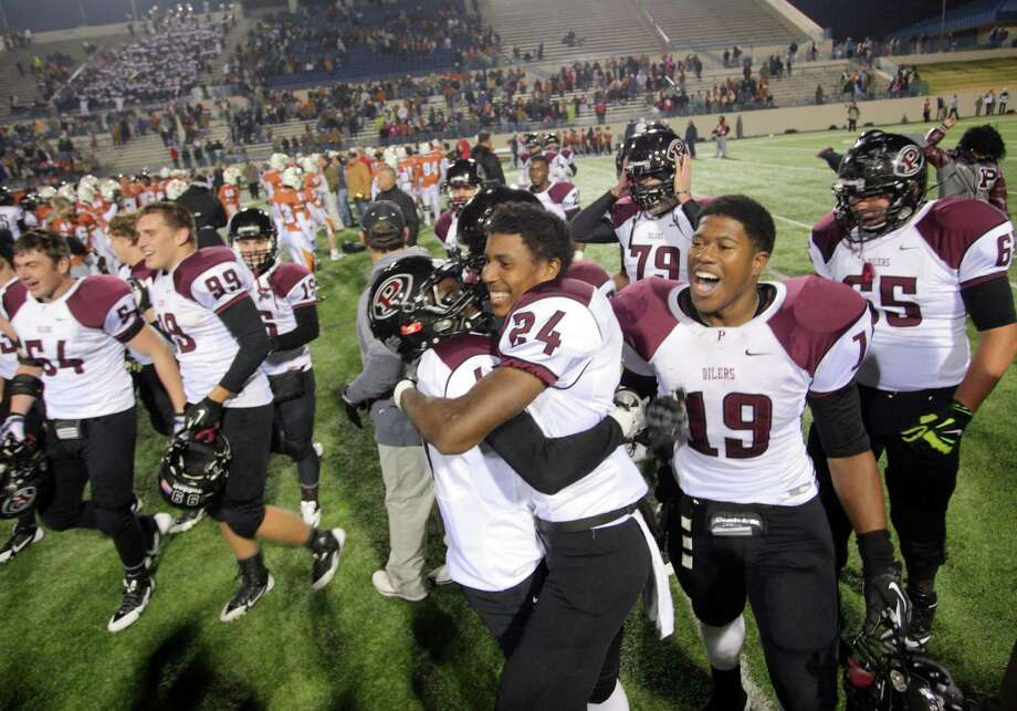 Pearland players celebrated after a 38-34 win over San Antonio Madison in a state semifinal game. Photo: Kar B Hlava, MBR / Conroe Courier