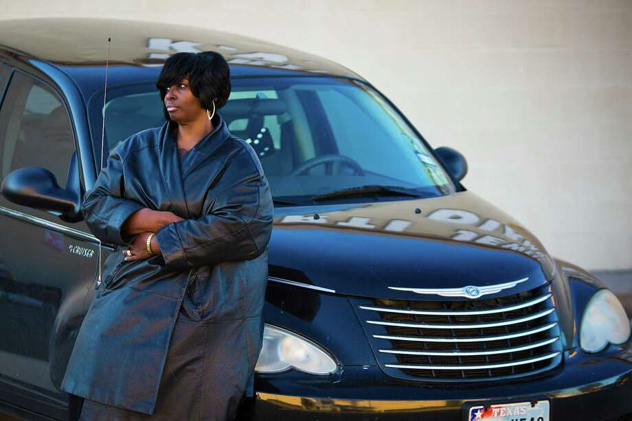 Yvonne Norris, who fears she will lose her late brother's car, is paying more in fees than the actual loan.  Photo: Marie D. De Jeséºs, Staff / © 2013 Houston Chronicle