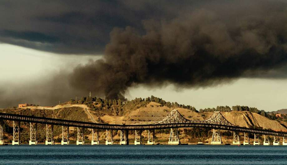 The fire at the Chevron refinery in Richmond, Calif., in August 2012 sent thousands of people to hospitals because of breathing problems. Photo: John Storey / ONLINE_Yes