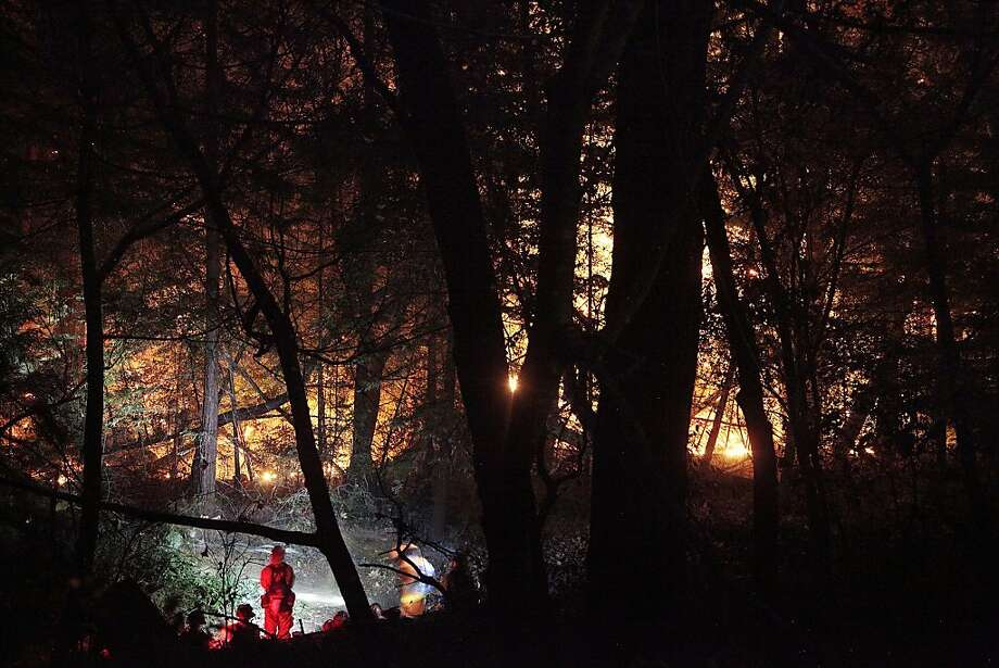 Firefighters work late into the night to contain a wildfire in Big Sur on Monday. A wildfire in Big Sur began yesterday morning and has burned more than 500 acres. Photo: James Tensuan, SFC