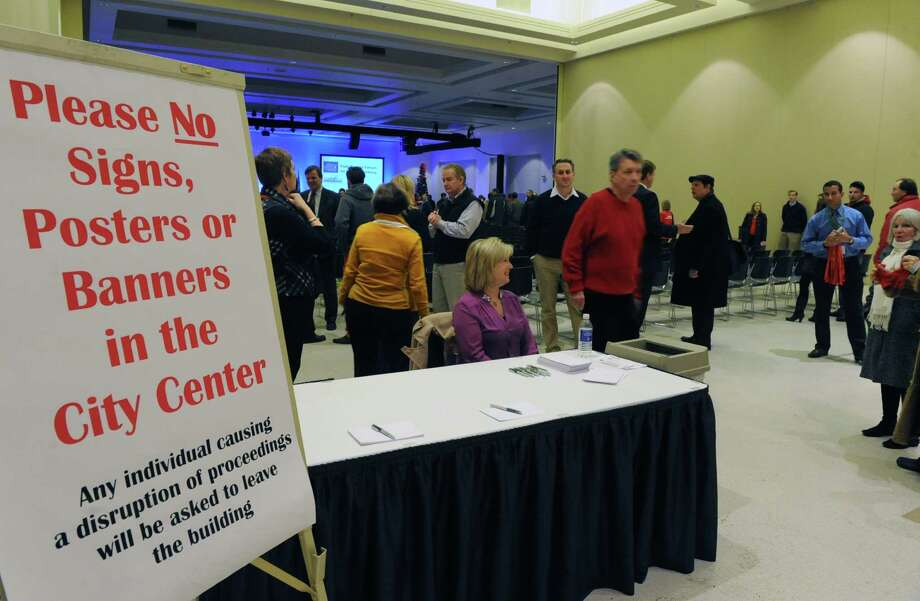 People arrive to a OFact Finding Roundtable PresentationO moderated by Matt Jones of the Jones Firm at the  Saratoga Springs City Center on Monday, Dec. 16, 2013 in Saratoga Springs, N.Y. The roundtable was hosted by The Saratoga County Chamber of Commerce and the Saratoga Convention and Tourism Bureau and discussions included impacts of a casino in Saratoga Springs. (Lori Van Buren / Times Union) Photo: Lori Van Buren / 00025035A