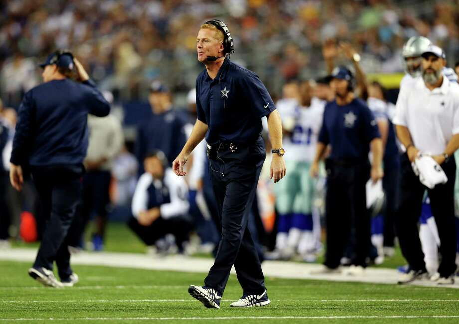 Cowboys coach Jason Garrett saw a 23-point lead against the Packers vanish on Sunday, the result of two late interceptions, questionable play-calling and clock management, and a porous Dallas defense. Photo: Ronald Martinez, Staff / 2013 Getty Images
