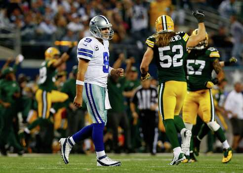 "Cowboys quarterback Tony Romo ""should have done a better job"" in the waning minutes of Sunday's 37-36 loss to the Packers, coach Jason Garrett said. But Garrett also put some of the blame for blowing a 23-point lead on himself and his staff. Photo: Tom Pennington / Getty Images / 2013 Getty Images"