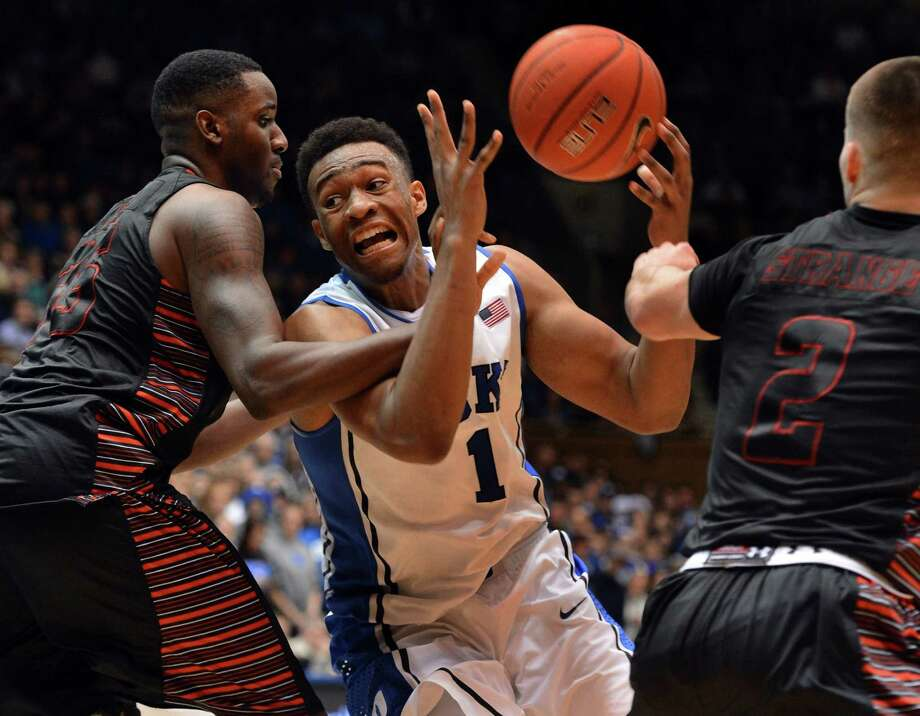 Duke's Jabari Parker, right, is roughed up by Jerome Hill, possibly because Parker scored 21 points. Photo: Chuck Liddy, MBR / Raleigh News & Observer