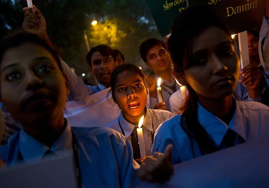 TOPSHOTS Indian students take part in a candle-light vigil commemorating the December 2012 fatal gang-rape of an Indian woman, in New Delhi on December 16, 2013. The fatal gang-rape of a student on a bus in New Delhi shattered India's silence over sexual violence and emboldened victims to speak out, family members and campaigners said on the first anniversary of the attack.   AFP PHOTO/ MANAN VATSYAYANAMANAN VATSYAYANA/AFP/Getty Images Photo: Manan Vatsyayana, AFP/Getty Images