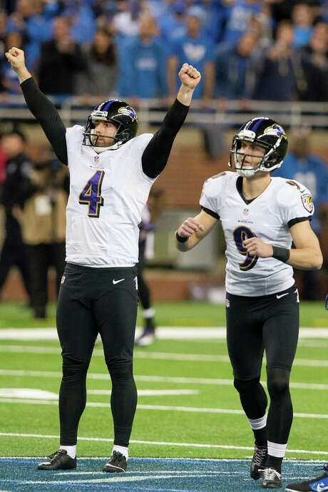 With holder Sam Koch (4) making the call, Baltimore kicker Justin Tucker watches as his game-winning 61-yard field goal clears the uprights to beat Detroit. Photo: Jason Miller, Stringer / 2013 Getty Images