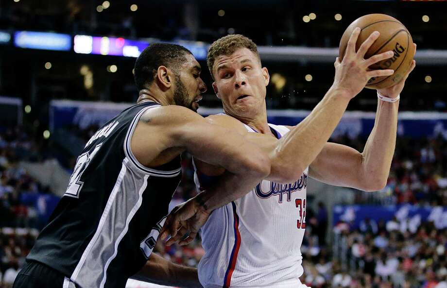 Los Angeles Clippers' Blake Griffin, right, is defended by San Antonio Spurs' Tim Duncan during the second  half of an NBA basketball game on Monday, Dec. 16, 2013, in Los Angeles. The Clippers won 115-92. (AP Photo/Jae C. Hong) Photo: Jae C. Hong, Associated Press / AP