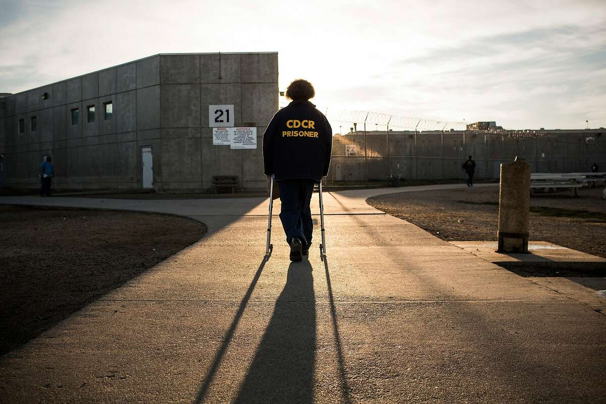 """VACAVILLE, CA - DECEMBER 16: (Editorial Use Only) George Whitfield, age 56, uses a walker to walk back to his cell block at California State Prison, Solano, on December 16, 2013 in Vacaville, California. This is Whitfield's fourth time in prison - his current sentence is six years. He was sentenced for possession of narcotics with intent to sell and an illegal firearm. Whitfield denies the charges, saying police searched his house without presenting a warrant and only found marijuana that he used personally and a firearm he kept in his home. His previous three sentences, dating back to 1989, were allegedly for possession of marijuana, which he says he has only used recreationally. According to Whitfield, he suffered a stroke in 2007, which now forces him to use a walker. He also suffers from high blood pressure and has recently experienced numbness in his left arm. While Whitfield believes the prison officials at Solano are """"fair, they're only doing their job,"""" he also laments, """"they should have sent me to rehab...they're not trying to save my life, they're trying to ruin it."""" He continued, """"I believe in second chances, I would love to see [some of my fellow inmates] go home - they don't belong in here. This is overkill....we're still human."""" As of June 2013, the state of California had 133,000 prisoners, of which approximately 15,000 were over the age of 55. According to a 2012 Human Rights Watch Report, """"incarcerated men and women typically have physiological and mental health conditions that are associated with people at least a decade older in the community. The U.S. incarcerates more people than any other country, with the number of inmates increasing 42 percent between 1995 and 2010, according to Human Rights Watch, and the number of prisoners 55-and-older skyrocketing by 282 percent. The increases are blamed..."""