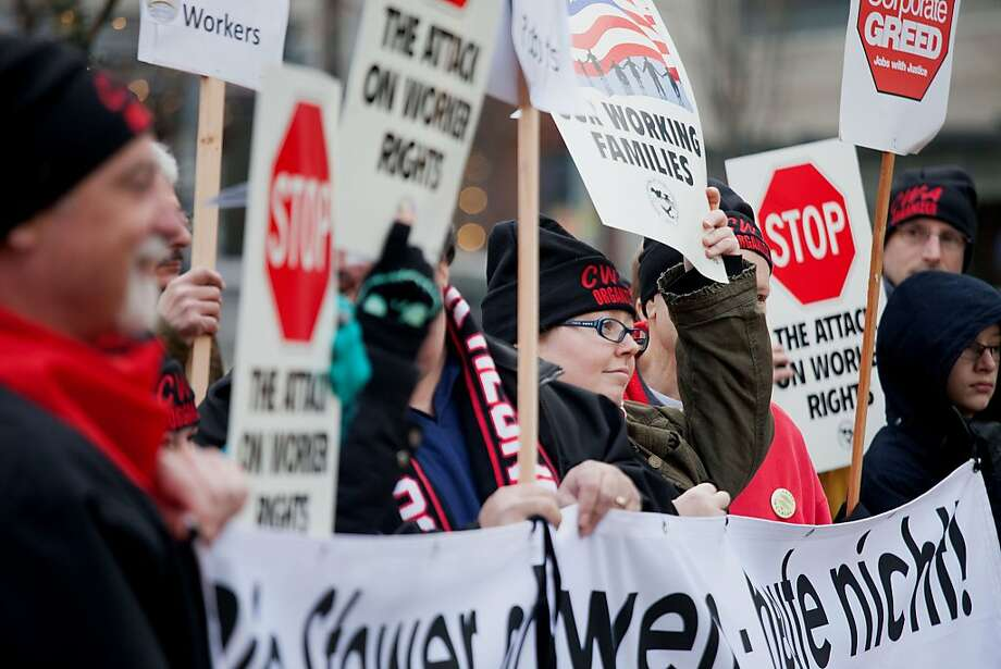 Demonstrators demand higher pay and better work conditions last week outside Amazon.com in Seattle. Photo: David Ryder, Bloomberg