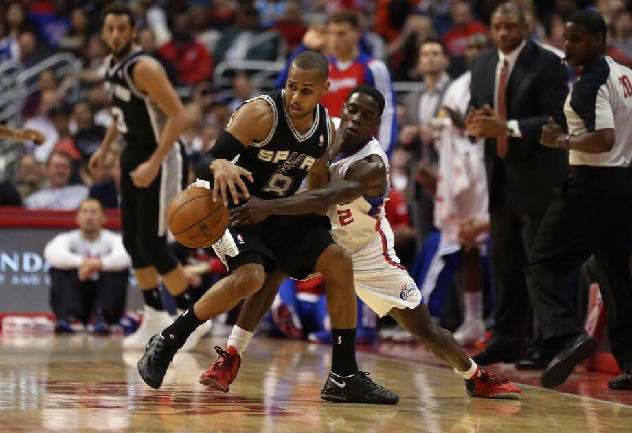 Darren Collison #2 of the Los Angeles Clippers steals the ball from Patty Mills #8 of the San Antonio Spurs in the first half at Staples Center on December 16, 2013 in Los Angeles, California. Photo: Jeff Gross, Getty Images