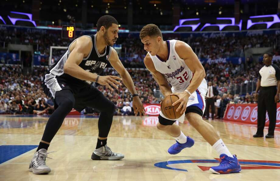 Blake Griffin #32 of the Los Angeles Clippers is defended by Jeff Ayres #11 of the San Antonio Spurs in the first half at Staples Center on December 16, 2013 in Los Angeles, California. Photo: Jeff Gross, Getty Images