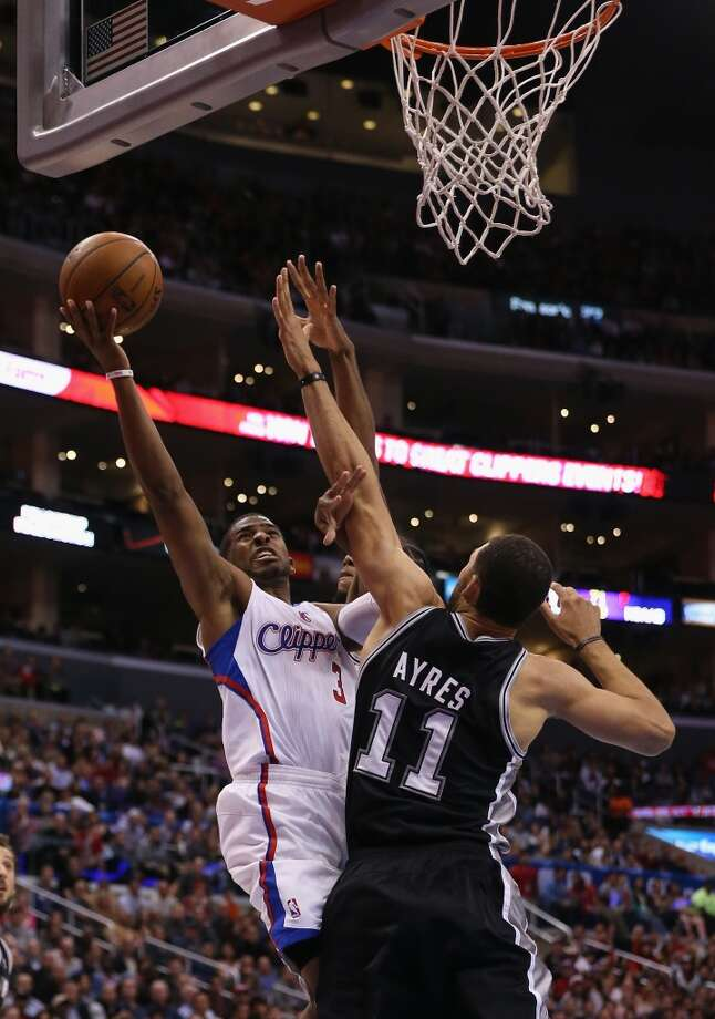 Chris Paul #3 of the Los Angeles Clippers drives to the basket while defended by Jeff Ayres #11 of the San Antonio Spurs in the first half at Staples Center on December 16, 2013 in Los Angeles, California. Photo: Jeff Gross, Getty Images