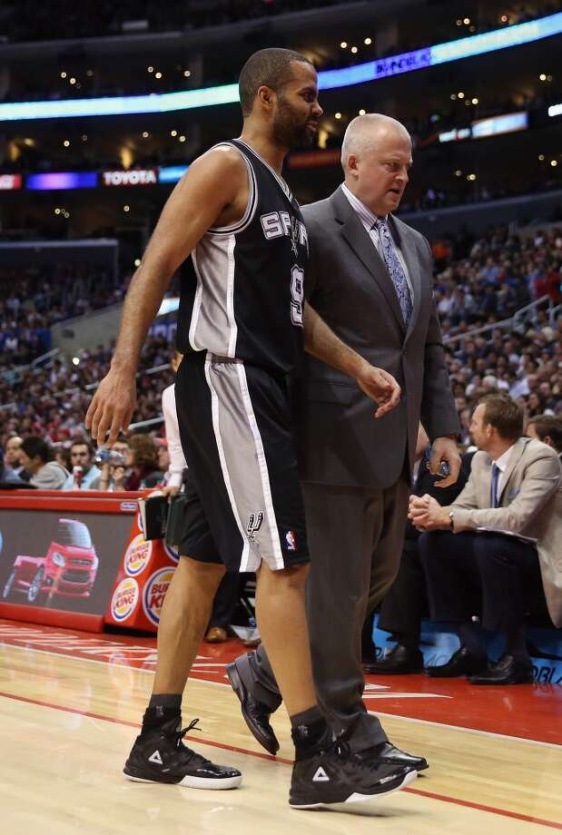 Tony Parker #9 of the San Antonio Spurs is taken off the floor after injuring himself in the second half against the Los Angeles Clippers at Staples Center on December 16, 2013 in Los Angeles, California. The Clippers defeated the Spurs 115-92. Photo: Jeff Gross, Getty Images