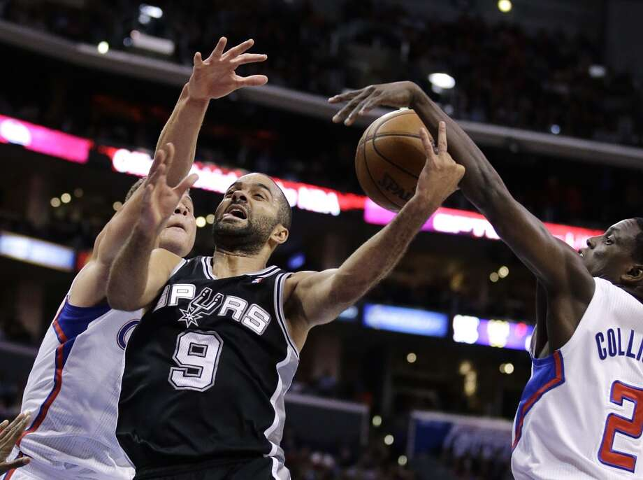 San Antonio Spurs' Tony Parker, center, of France, is defended by Los Angeles Clippers' Blake Griffin, left, and Darren Collison during the first half of an NBA basketball game on Monday, Dec. 16, 2013, in Los Angeles. Photo: Jae C. Hong, Associated Press