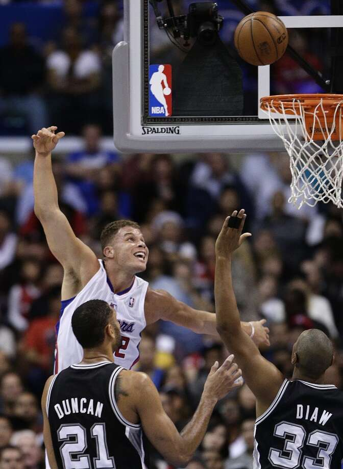 Los Angeles Clippers' Blake Griffin, top left, puts up a shot as San Antonio Spurs' Tim Duncan, bottom left, and Boris Diaw watch during the first half of an NBA basketball game on Monday, Dec. 16, 2013, in Los Angeles. Photo: Jae C. Hong, Associated Press