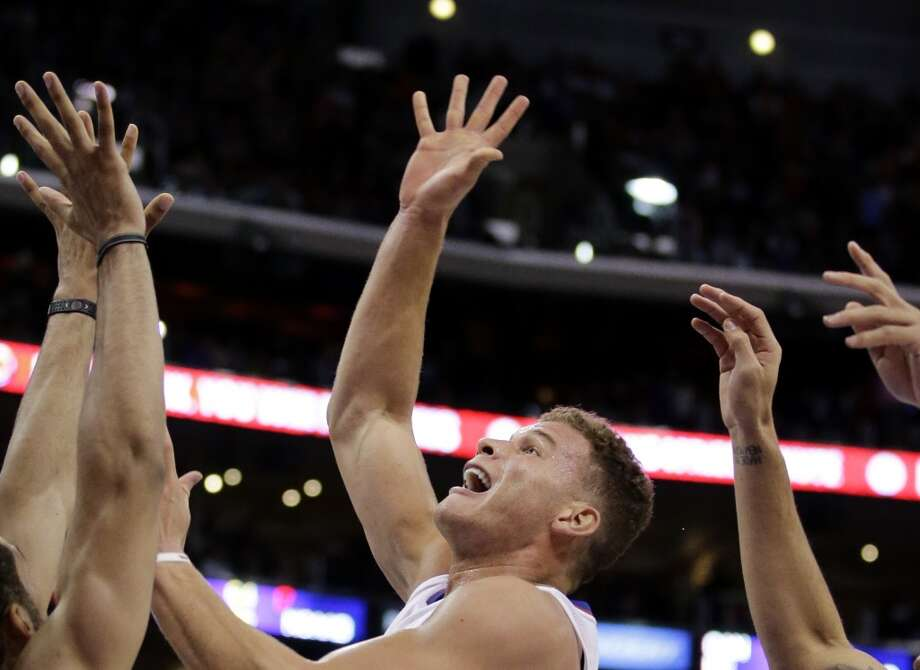 Los Angeles Clippers' Blake Griffin puts up a shot against the San Antonio Spurs during the second  half of an NBA basketball game on Monday, Dec. 16, 2013, in Los Angeles. The Clippers won 115-92. Photo: Jae C. Hong, Associated Press