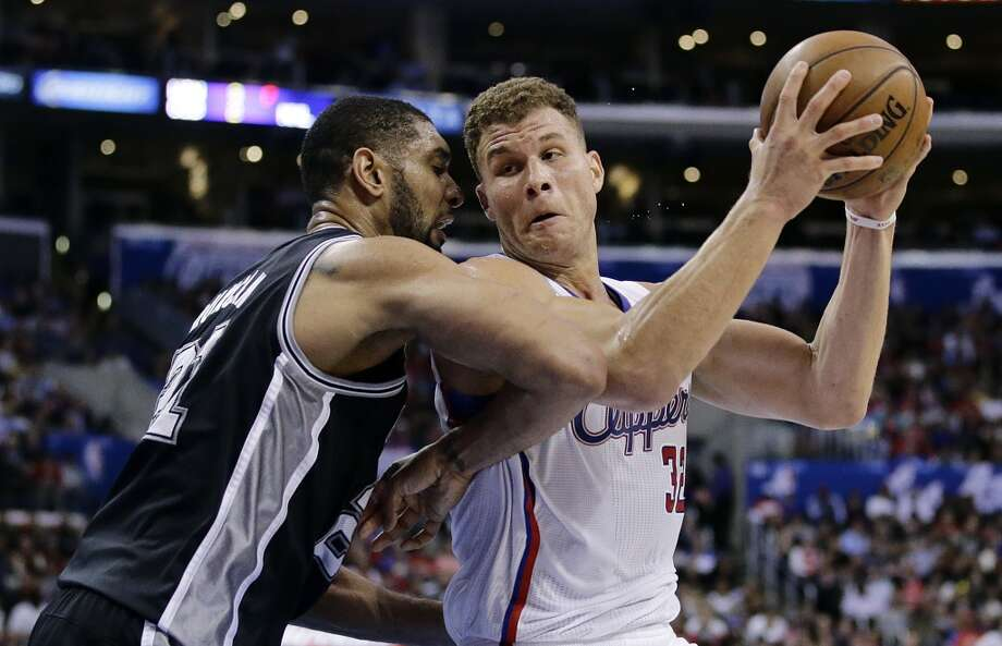 Los Angeles Clippers' Blake Griffin, right, is defended by San Antonio Spurs' Tim Duncan during the second  half of an NBA basketball game on Monday, Dec. 16, 2013, in Los Angeles. The Clippers won 115-92. Photo: Jae C. Hong, Associated Press