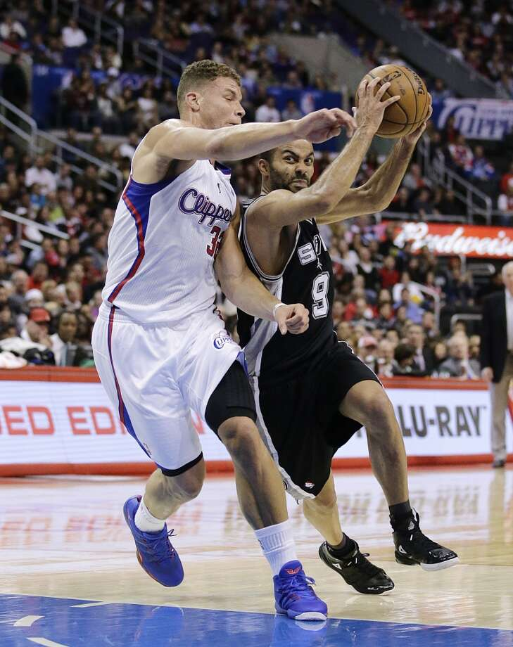 Los Angeles Clippers' Blake Griffin, left, defends San Antonio Spurs' Tony Parker, of France, during the first half of an NBA basketball game on Monday, Dec. 16, 2013, in Los Angeles. Photo: Jae C. Hong, Associated Press