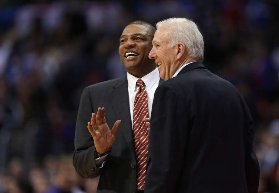 Los Angeles Clippers head coach Doc Rivers and San Antonio Spurs head coach Gregg Popovich share a laugh at the conclusion of the game at Staples Center on December 16, 2013 in Los Angeles, California. The Clippers defeated the Spurs 115-92. Photo: Jeff Gross, Getty Images
