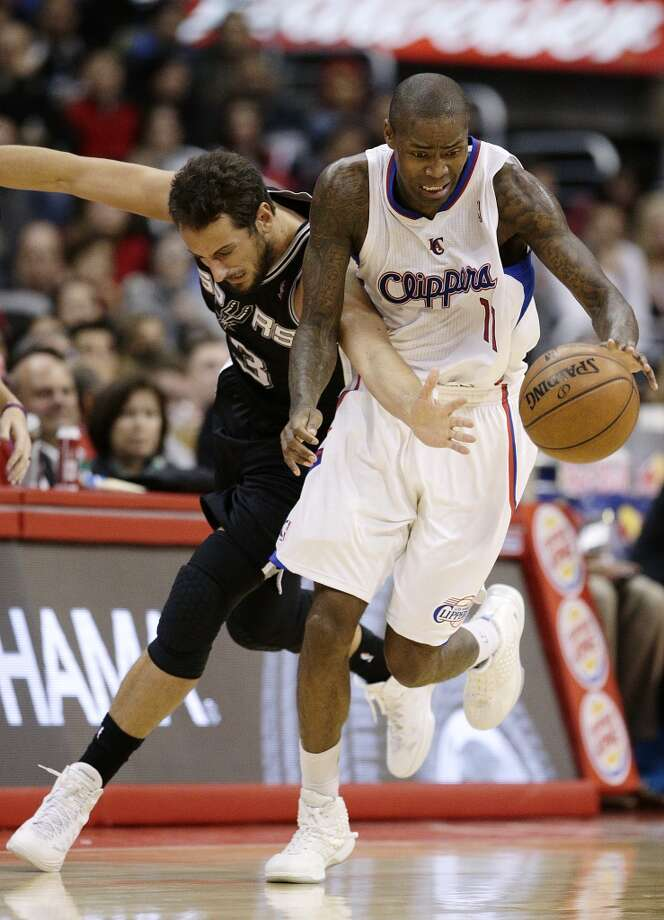 Los Angeles Clippers' Jamal Crawford, right, gets a loose ball against San Antonio Spurs' Marco Belinelli, of Italy, during the second  half of an NBA basketball game on Monday, Dec. 16, 2013, in Los Angeles. The Clippers won 115-92. Photo: Jae C. Hong, Associated Press