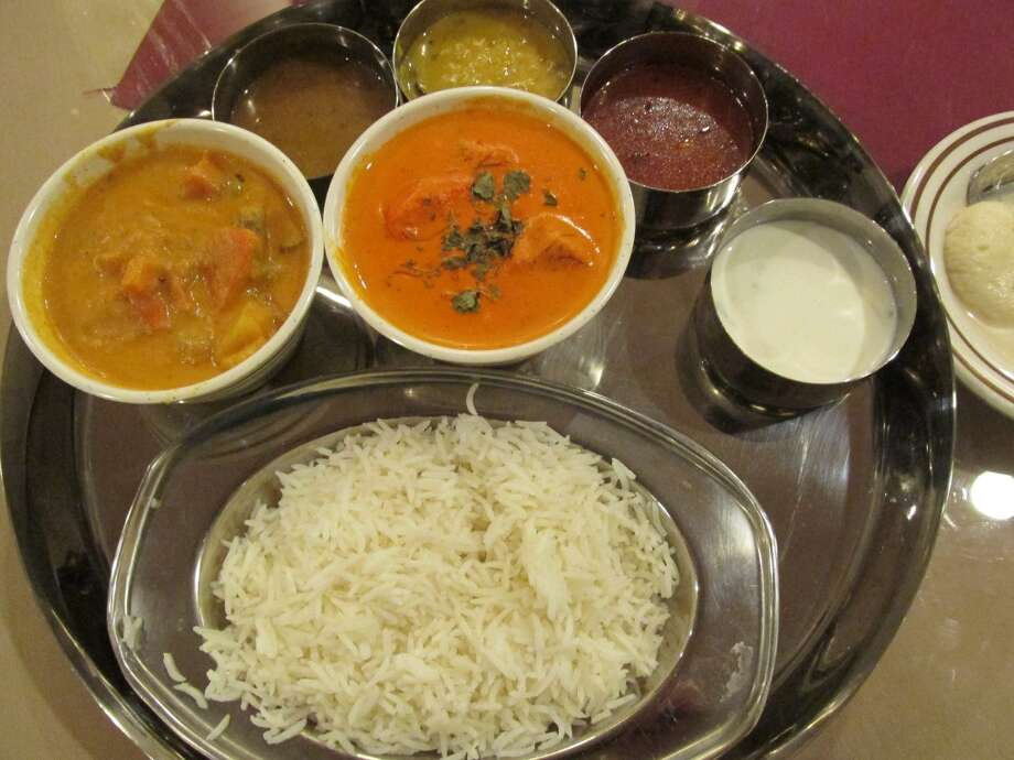 Taz Indian Cuisine's First Timer Special with lentil soup, vegetable curry and chicken tikka masala. Photo: Cat5