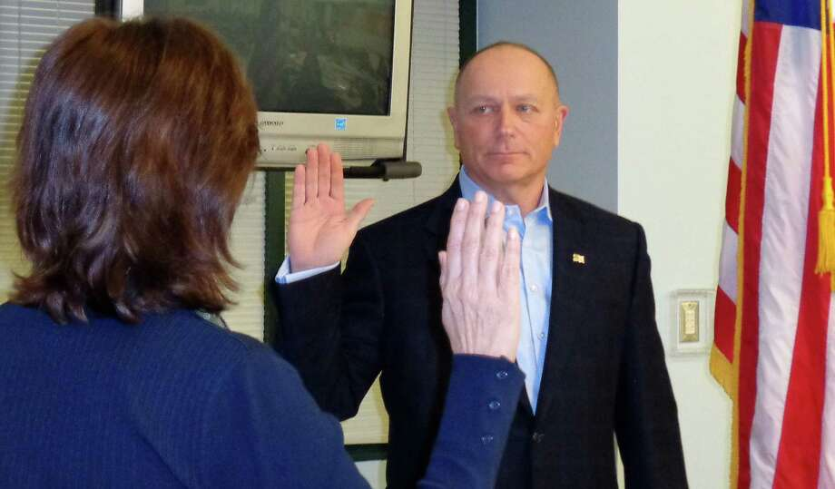 Paul Block, a Republican business executive, is sworn in by Town Clerk Patricia Strauss to a vacant Board of Education seat Monday night. Photo: Meg Barone / Westport News contributed