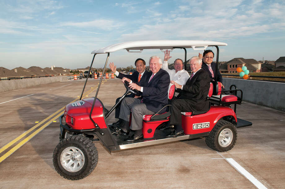 Larry Johnson takes the first drive across the new bridge with Larry Wong, Allen Owen, Charlie Pence and Rocky Lai.