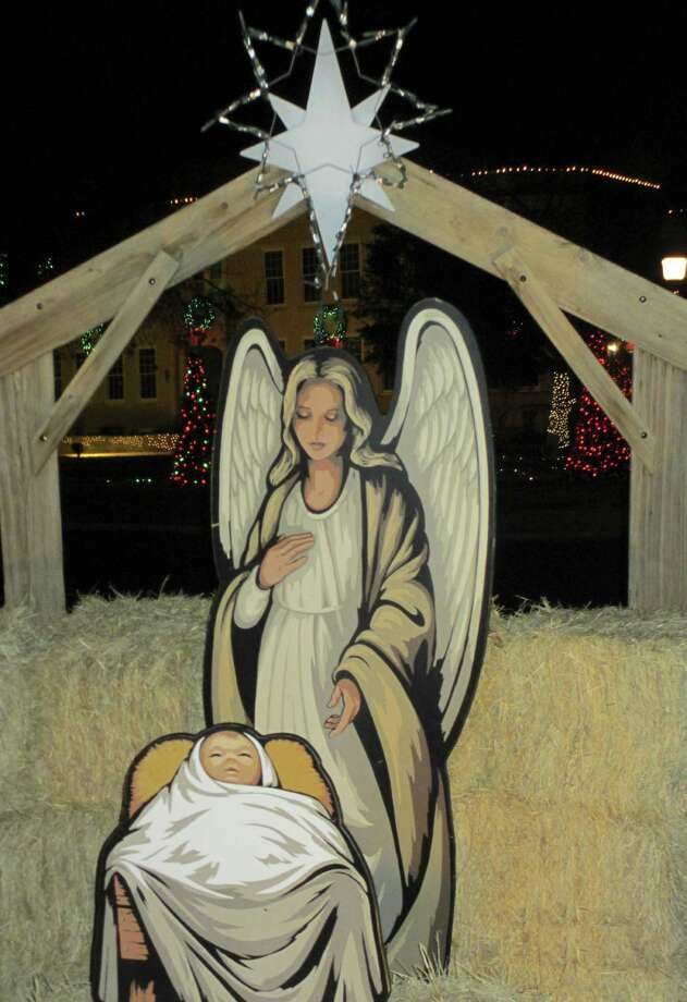 The manger scene on the Kerr County Courthouse Square is beautifully painted and illuminated with spotlights.