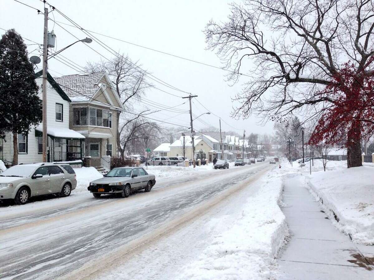 Cars move down snowy Eastern Avenue in Schenectady on Tuesday, Dec. 17, 2013. (Skip Dickstein / Times Union)