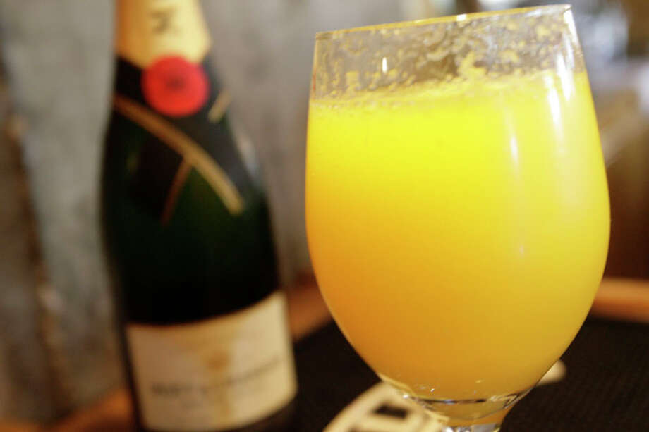 Bottomless brunch?Mimosa's are a staple of weekend brunch, but a bottomless serving of booze is prohibited in Texas. You'll have to buy your drinks one at a time. Photo: Julio Cortez, Houston Chronicle / Houston Chronicle