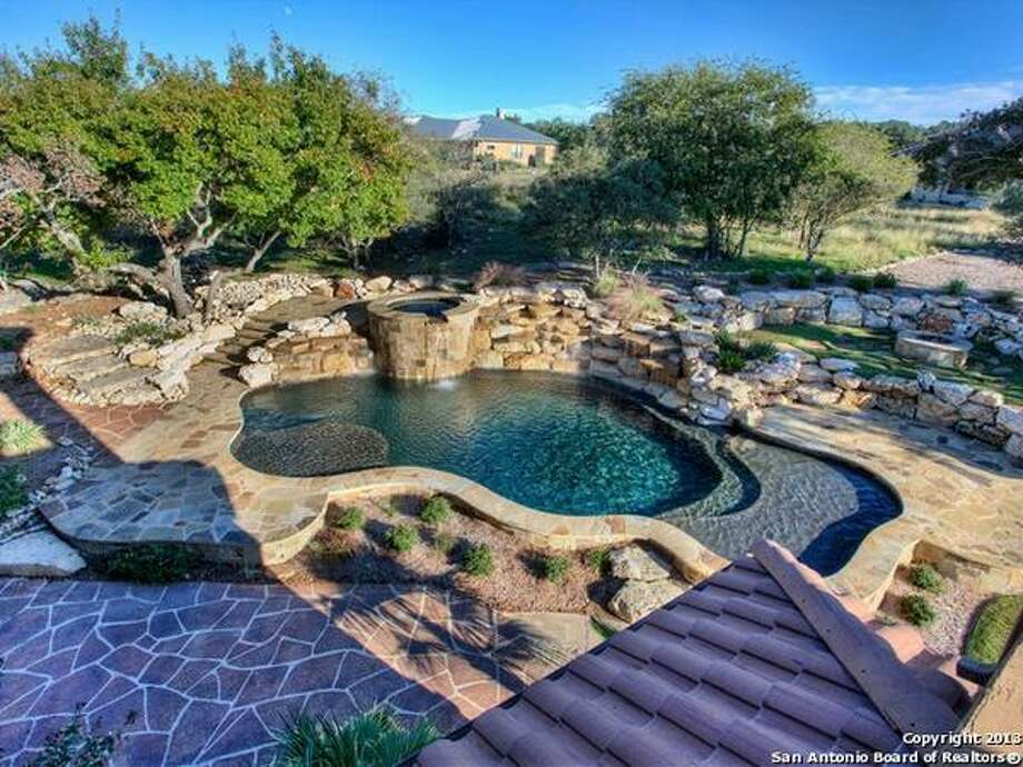 Cascading pool with waterfall & spa, endless flagstone, massive yard & detached casita w/RV parking & additional 4-car garage with maids quarters.  Photo: Courtesy