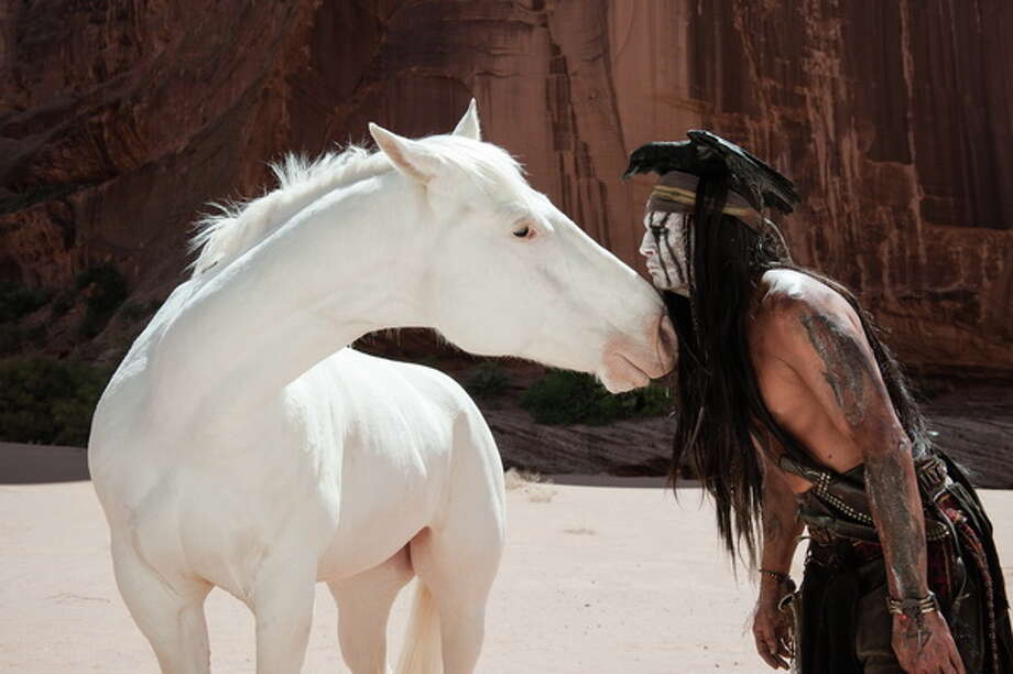 "Silver and Johnny Depp as Tonto in ""The Lone Ranger."" Photo: Peter Mountain/Disney, 2013 / ©Disney Enterprises, Inc. and Jerry Bruckheimer Inc.  All Rights Reserved."