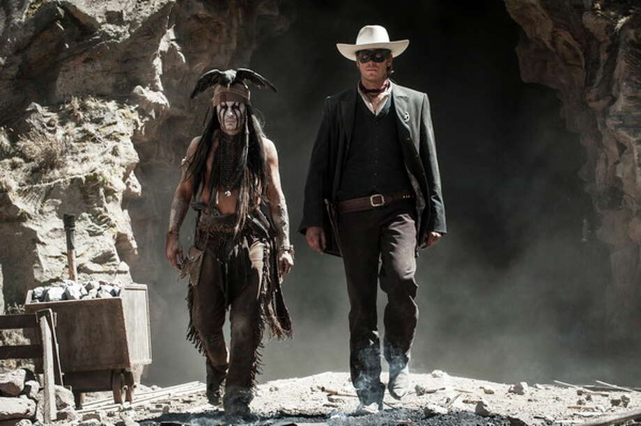 Johnny Depp as Tonto and Armie Hammer as The Lone Ranger. Photo: Peter Mountain/Disney, 2013 / ©Disney Enterprises, Inc. and Jerry Bruckheimer Inc.  All Rights Reserved.