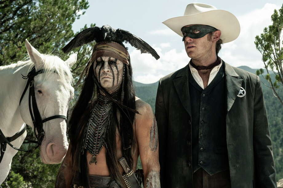 Silver, Johnny Depp as Tonto and Armie Hammer as The Lone Ranger. Photo: Peter Mountain/Disney, 2013 / ©Disney Enterprises, Inc. and Jerry Bruckheimer Inc.  All Rights Reserved.