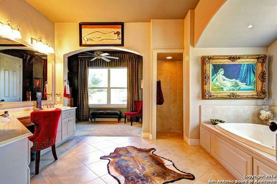 Master suite with spa-like bath, jetted tub, dual vanities & walk-in closets.  Photo: Courtesy