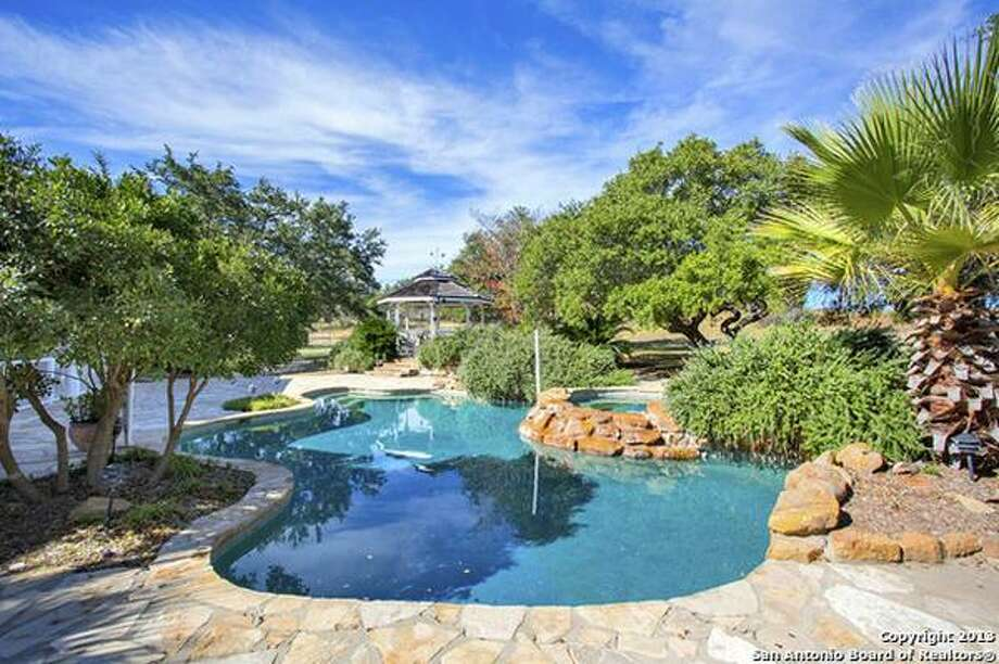 Park-like grounds, 3 covered living areas, pool, spa and gazebo. Photo: Courtesy
