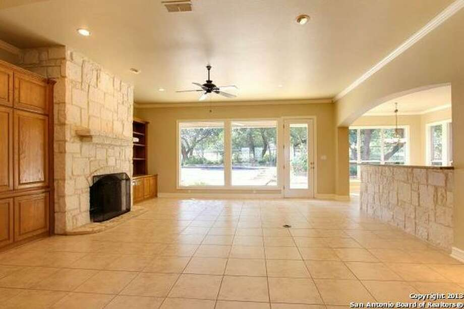 Spacious floor plan, formal and casual dining areas, gourmet kitchen, private study, great room with fireplace and built-ins. Photo: Courtesy