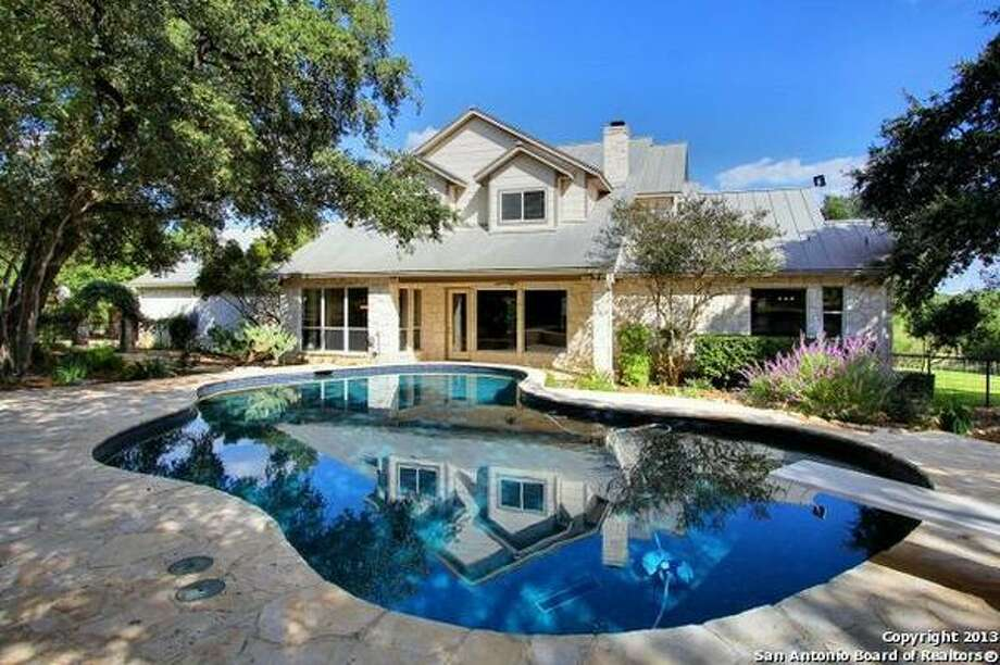 Abundance of windows, high ceilings, crown mouldings and bonus walk-in storage room. Outdoor living areas, pool, fenced and cross fenced and lush horse friendly pastures. Photo: Courtesy