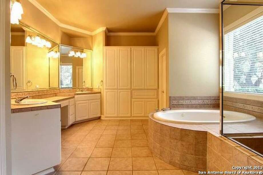 Split downstairs master suite features spa bath. Photo: Courtesy