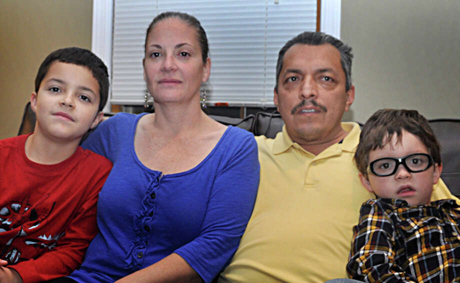 Dawn and Ruperto Calle with their sons, Mathew, left, and Adam. In late October, Dawn donated a kidney to her husband during successful transplant surgery at Yale-New Haven Hospital. Photo: Nancy Guenther Chapman / Norwalk Citizen contributed