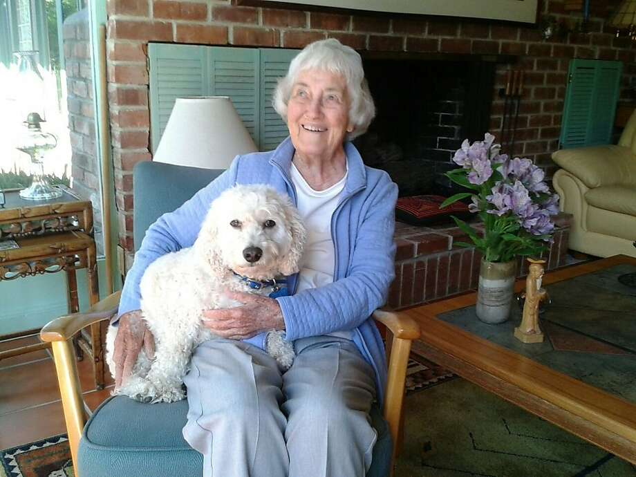 Cynthia Hardie holds her companion Beau. Hardie agreed to temporarily foster Beau because she didn't want to adopt a dog - but it didn't take long for the two to grow inseparable. Photo: Courtesy Barbara Marall