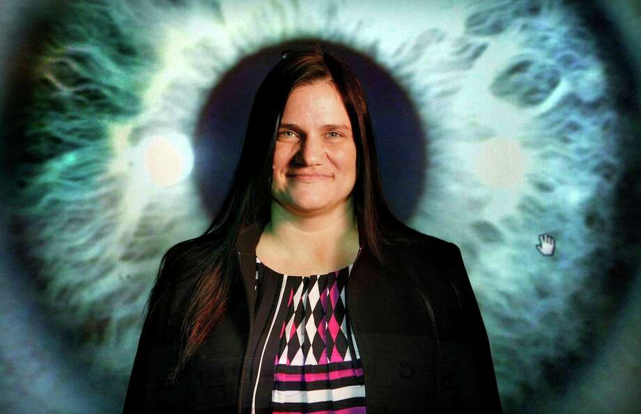 Faith Bost, an iridologist, examines people's irises for signs of illness and emotional stress. Photo: Johnny Hanson, Staff / Houston Chronicle
