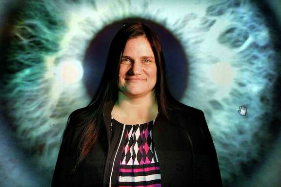 Faith Bost, an iridologist, examines people's irises for signs of illness and emotional stress.